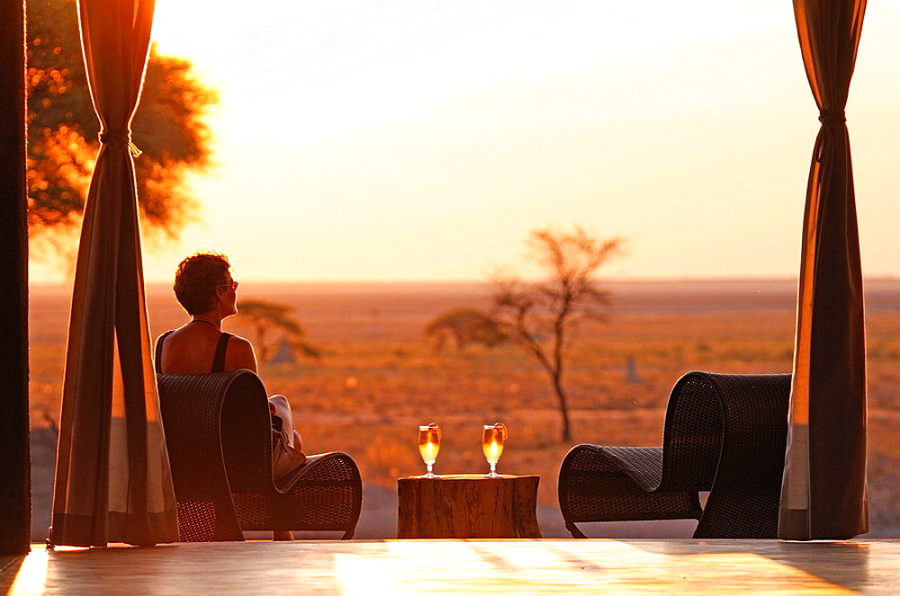 Sundowner, sunset, drink served, deck, The Fort, Fishers Pan, Onguma Safari Camp, Etosha, National Park, Kunene Region, Namibia, Africa, Travel, Nature. Sundowner, sunset, drink served, deck, The Fort, Fishers Pan, Onguma Safari Camp, Etosha, National Park, Kunene Region, Namibia, Africa, Travel, Nature - 817-306669