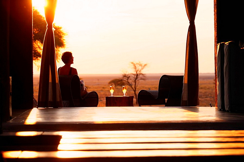 Sundowner, sunset, drink served, deck, The Fort, Fishers Pan, Onguma Safari Camp, Etosha, National Park, Kunene Region, Namibia, Africa, Travel, Nature. Sundowner, sunset, drink served, deck, The Fort, Fishers Pan, Onguma Safari Camp, Etosha, National Park, Kunene Region, Namibia, Africa, Travel, Nature