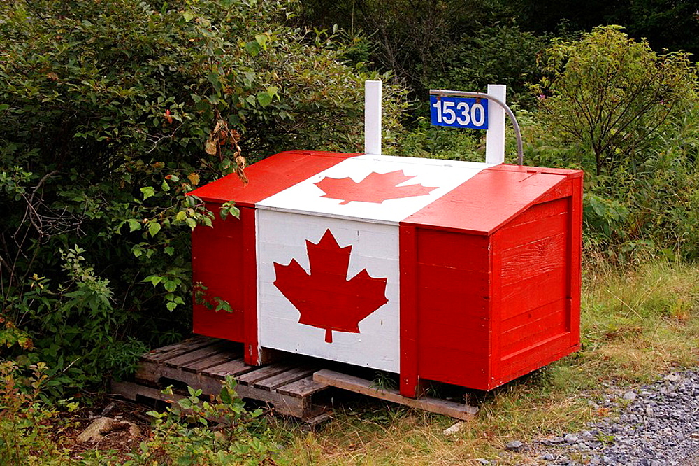 Wooden garbage box with canada flag symbol painted on it, Nova Scotia, Canada