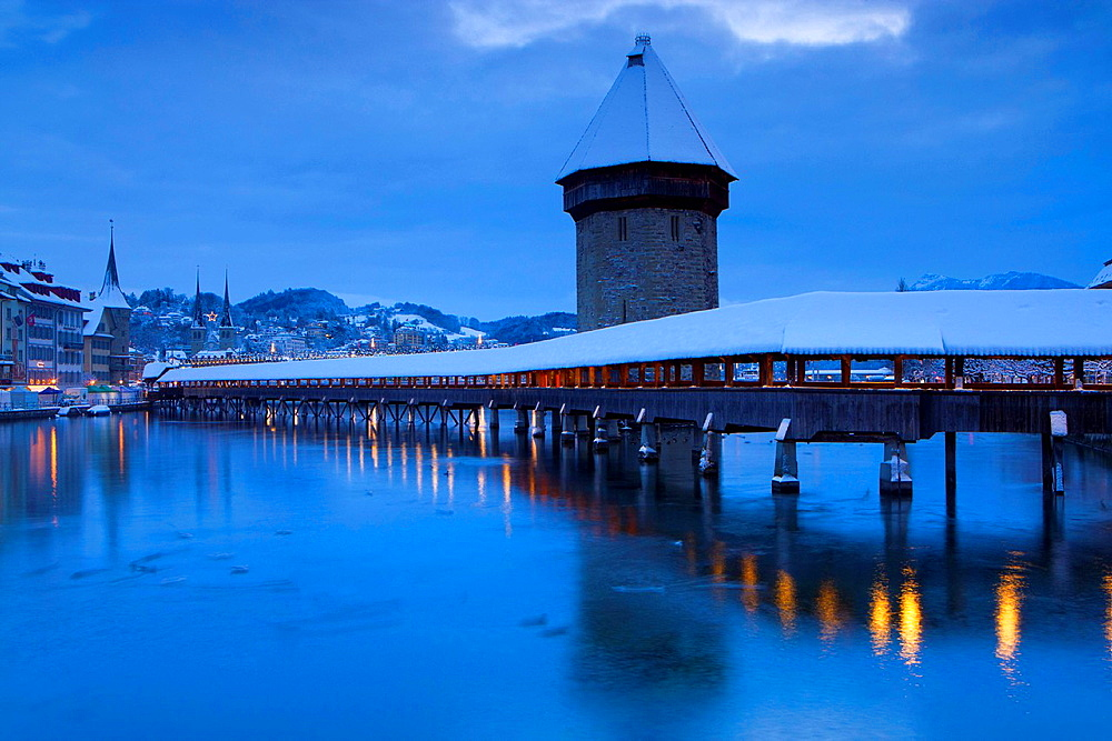 Lucerne chapel bridge, Switzerland, canton Lucerne, town, city, river, flow, Reuss, houses, homes, bridge, daybreak, lights, illumination, Christmas, lighting, snow, winter. Lucerne chapel bridge, Switzerland, canton Lucerne, town, city, river, flow, Reuss, houses, homes, bridge, daybreak, lights, illumination, Christmas, lighting, snow, winter
