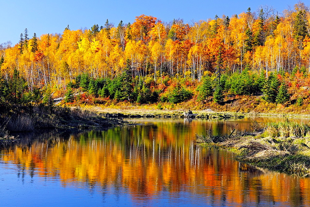 Autumn reflections in Junction Creek Greater Sudbury Ontario