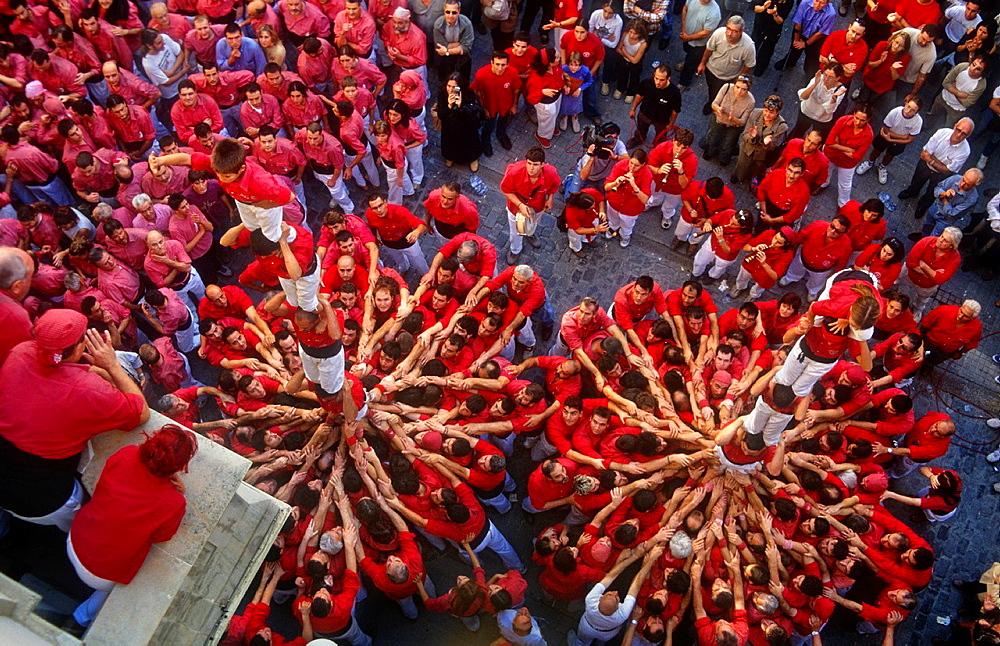 Colla Joves Xiquets de Valls Castellers building human tower, a Catalan tradition Plaça del Blat Valls Tarragona province, Catalonia, Spain