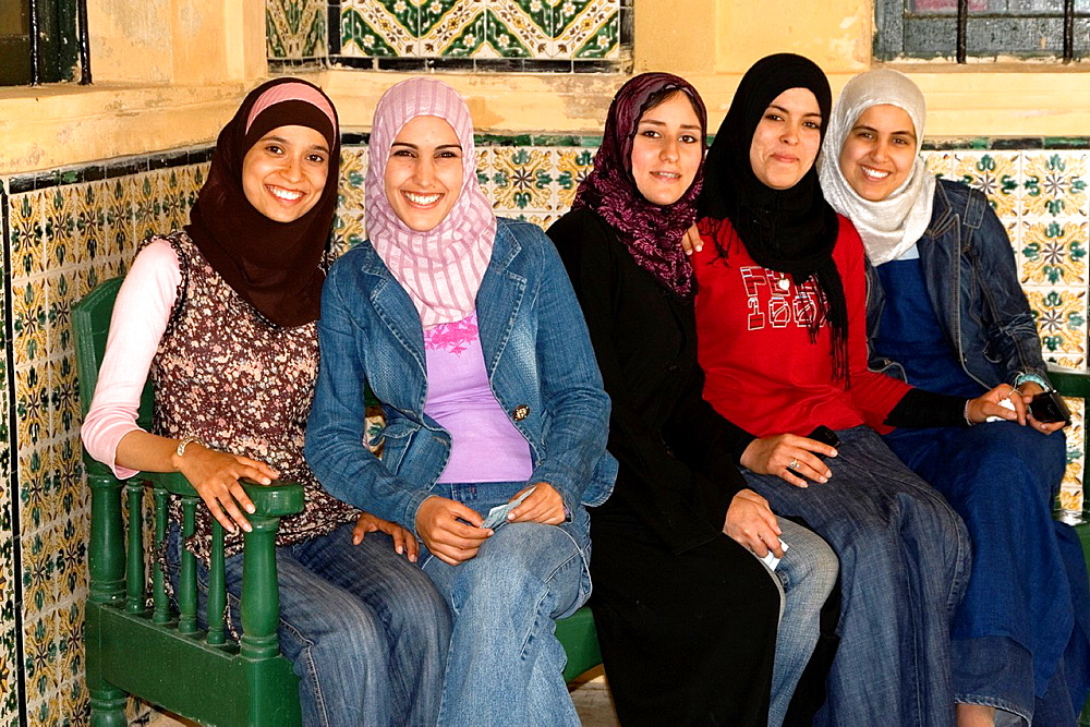 Tripoli, Libya, Young Libyan Women These women have adopted western European or American clothing styles while maintaining the Libyan custom of covering the hair with a scarf