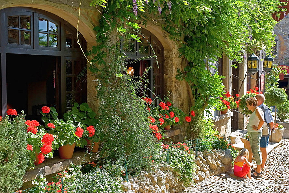 Restaurant windows with geranium flowers, Perouges medieval town, Rhone-Alpes, France
