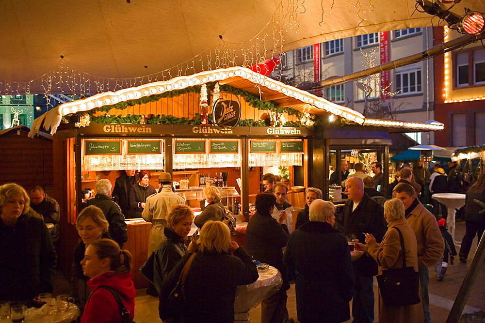 "Hot spiced wine and pancake merchant at christmas market ""Offenburg"" Baden-Wurttemberg, Germany"