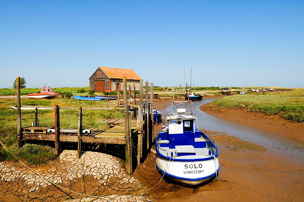 Boats in The Harbour at Thornham, Norfolk, England, UK