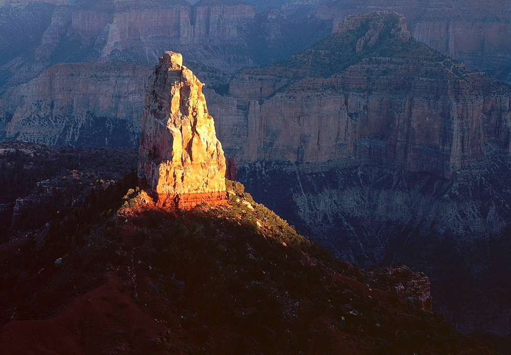 Sunset defines Mt  Hayden against shadowed canyon walls, view south from Point Imperial, North Rim, Grand Canyon National Park, Arizona, USA