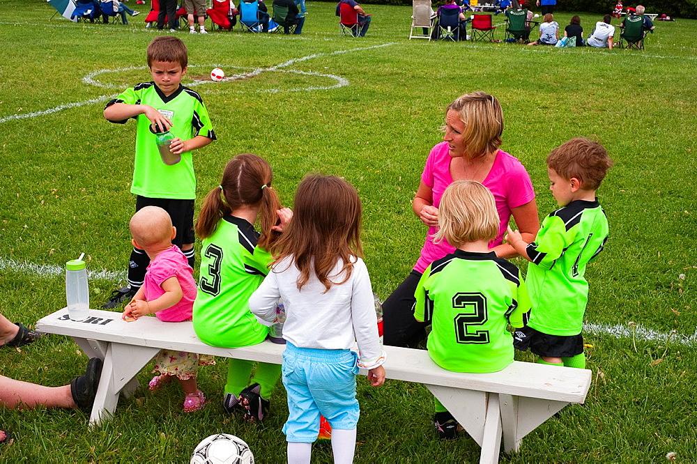 Soccer mom coaching kids league in Sheridan, Indiana, USA