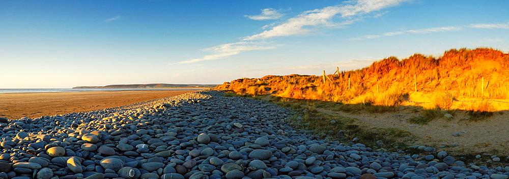 The pebble ridge at Westward Ho! beach by Northam Burrows sand dunes, Devon, England, United Kingdom