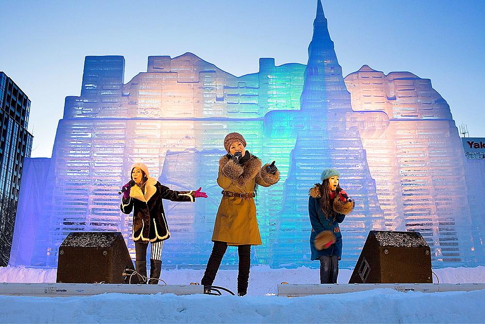 performance, Sapporo snow festival, in background ice sculpture, Odori Park, Sapporo, Hokkaido, Japan - 817-315862