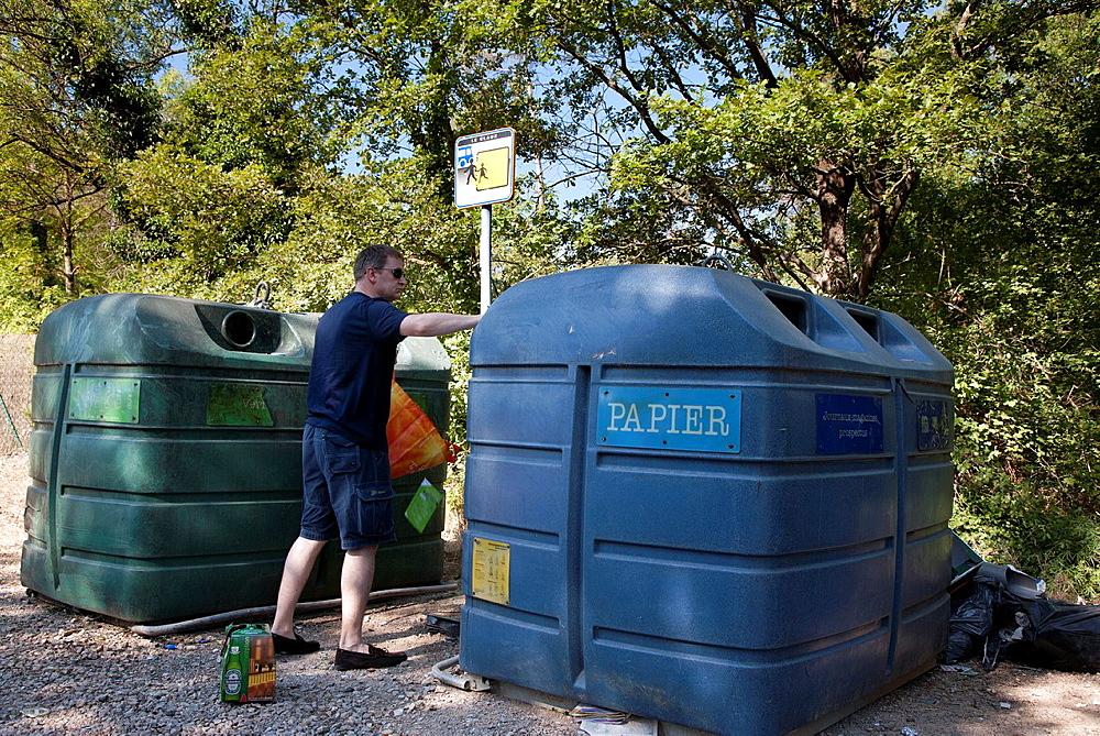 Man using recycle bins in Provence, France