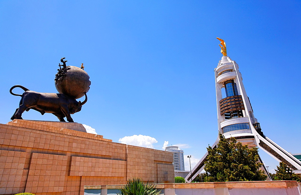 Turkmenistan - Ashgabat - the Earthquake memorial statue and the Arch of Neutrality