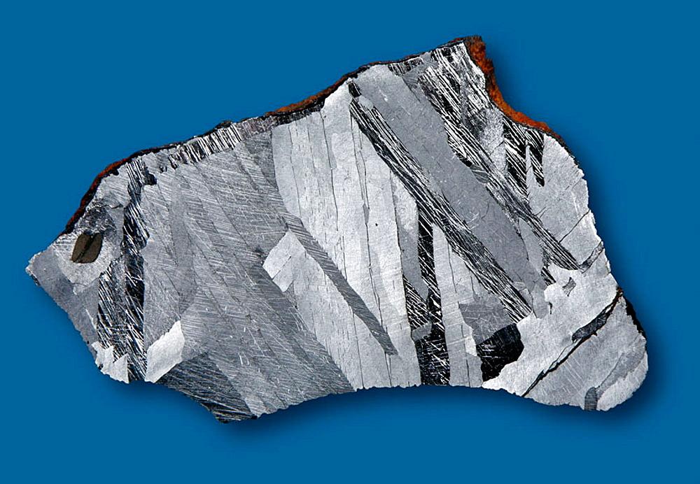 Henbury iron-meteorite;  classification: Octahedrite IIIAB; habitat: North-Australia, Henbury 24¬8 34'S,  133¬8 10'E;  age: ca 4,5 billions years, finding year: 1931; Meteorite with Widmanstatten figures and Neumann lines.