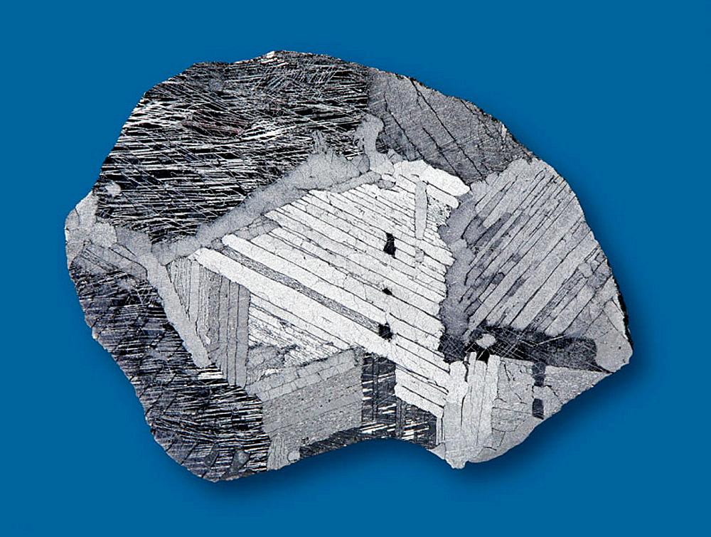 Mundrabilla iron-meteorite;   classification:  Octahedrite IIICD; habitat: Mundrabilla, Nullarbor Plain, West-Australia,  30¬8 47'S,   127¬8 33'E; age: ca 4,5 billions years; finding year: 1911;  Widmanstatten figures and Neumann lines;