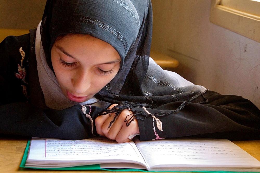 Surman, Libya Girl Studying Koranic Verses in the Madrasa of Sidi Rashid al-Galili Young girls wear the traditional Libyan head scarf