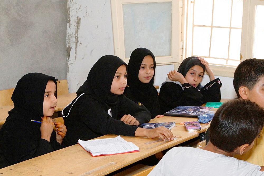 Surman, Libya Girls in the Madrasa of Sidi Rashid al-Galili, where they study to memorize the Koran Young girls wear the traditional Libyan head scarf