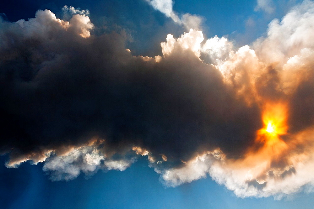 View of sun shining through volcanic ash cloud during Mount Etna eruption on 8th September 2011, Sicily, Italy