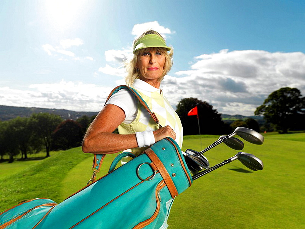 Mature lady playing golf, Mature lady playing golf