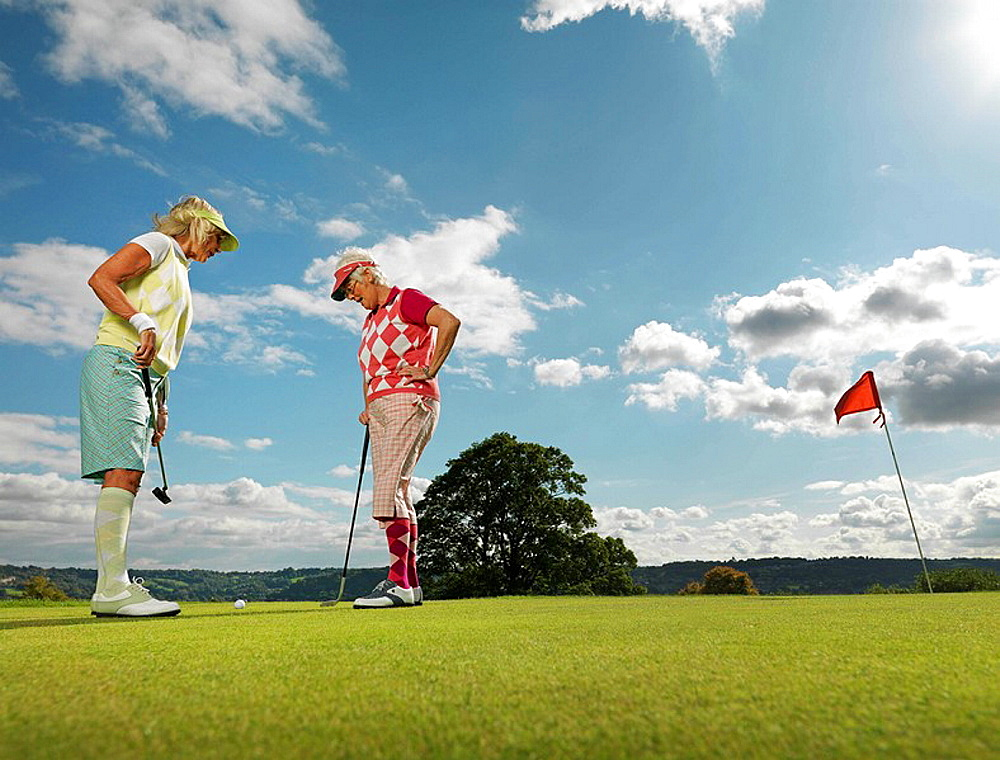 Mature ladies playing golf, Mature ladies playing golf