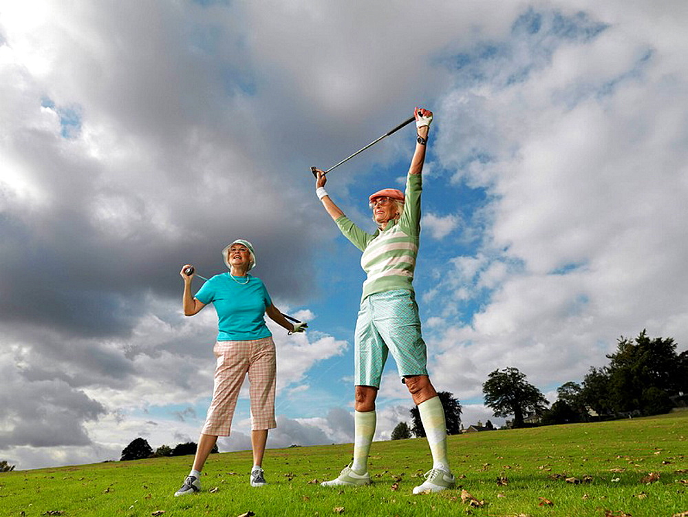 Mature ladies preparing to playing golf, Mature ladies preparing to playing golf