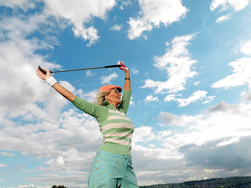 Mature lady preparing to playing golf, Mature lady preparing to playing golf