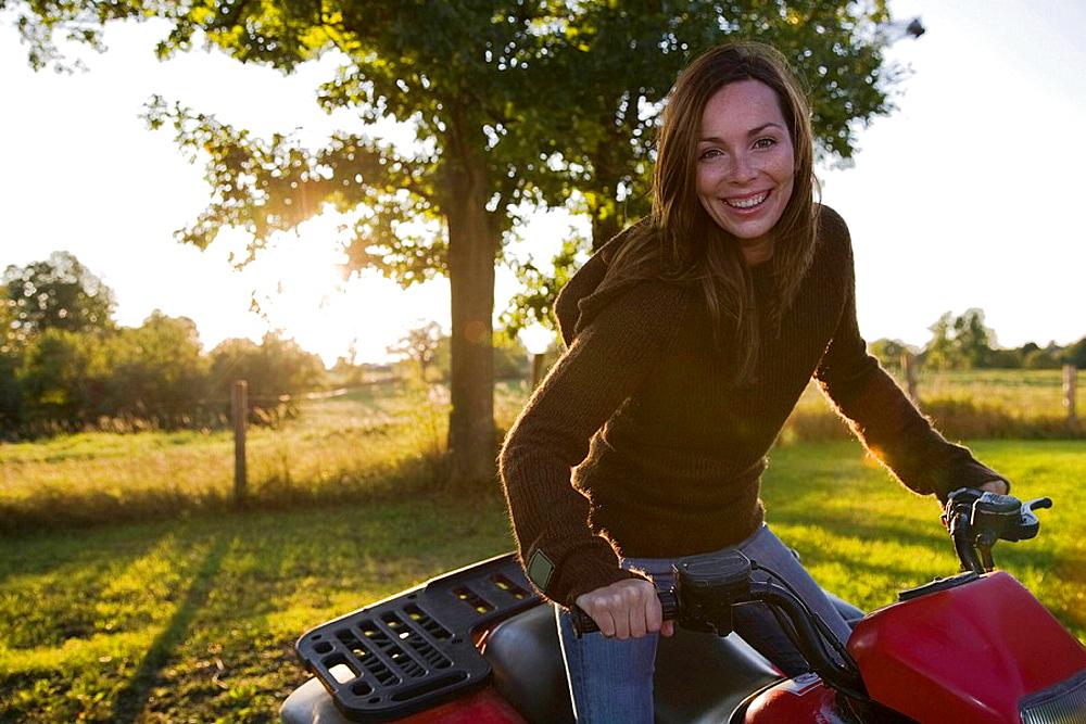 Woman on four wheeler