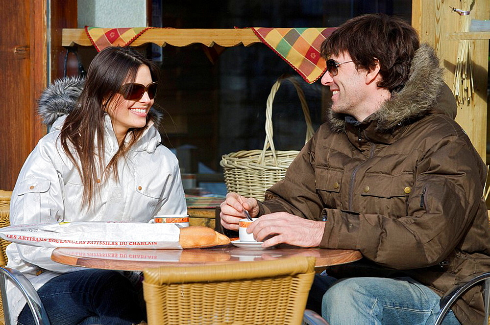 Couple in casual ski wear, Couple in casual ski wear, drinking coffee at a cafe