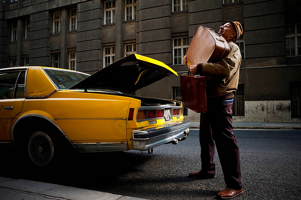 Taxi Driver struggling with luggage