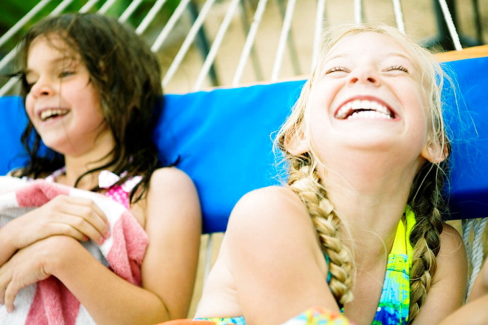 2 young girls laughing in hammock, 2 young girls laughing in hammock