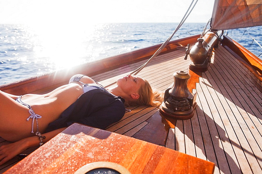 woman lying on deck eyes closed