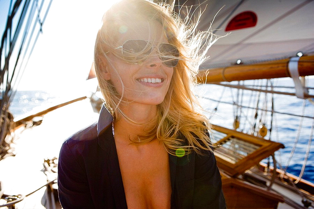 woman on a sailing boat smiling