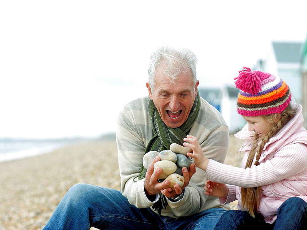 Grandfather and Granddaughter at beach, Grandfather and Granddaughter at beach