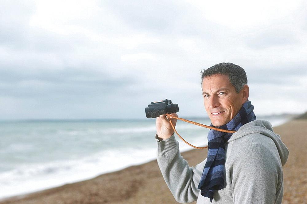 Man with Binoculars on Beach, Man with Binoculars on Beach