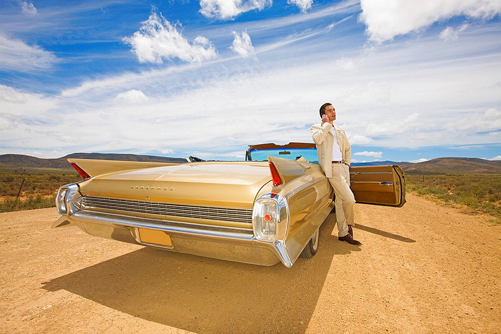 Lonely driver, Desert, convertible car, dark haired man, mobile phone