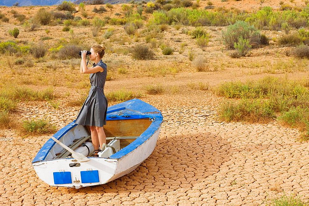 Desert, Blond business woman, rowingboat, dry desert