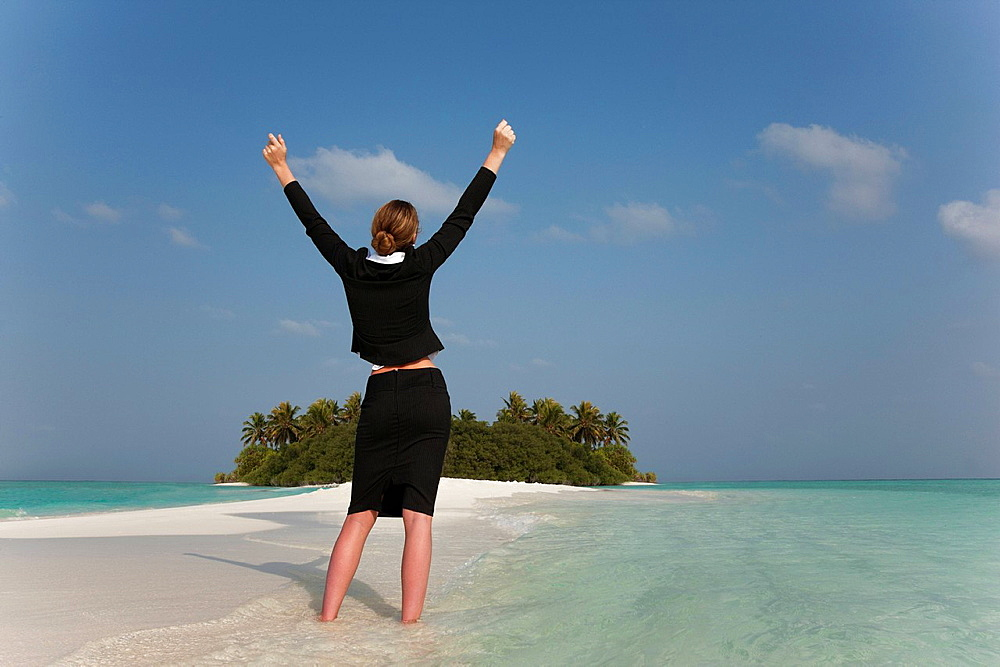 Businesswoman cheering on tropical beach, Businesswoman cheering on tropical beach