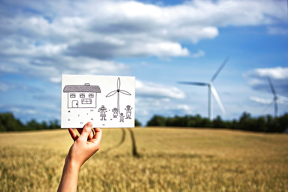 Woman with drawing at wind turbines, Woman with drawing at wind turbines