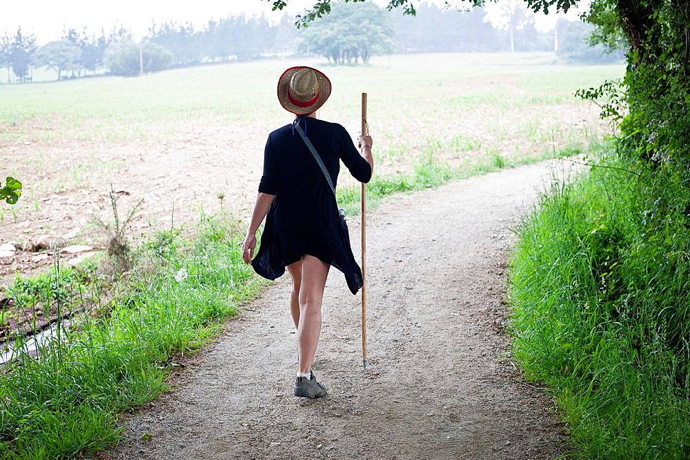 A women walking the Camino de Santiago near the village of Casanova