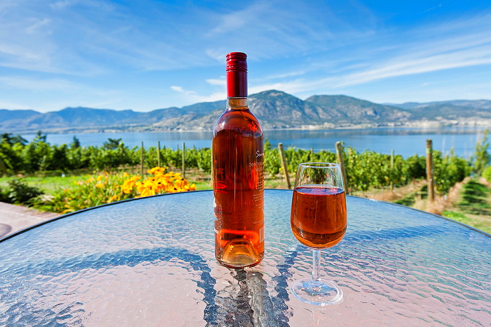 A bottle and a glass of rose wine at a vineyard in the Okanagan Valley, British Columbia, Canada