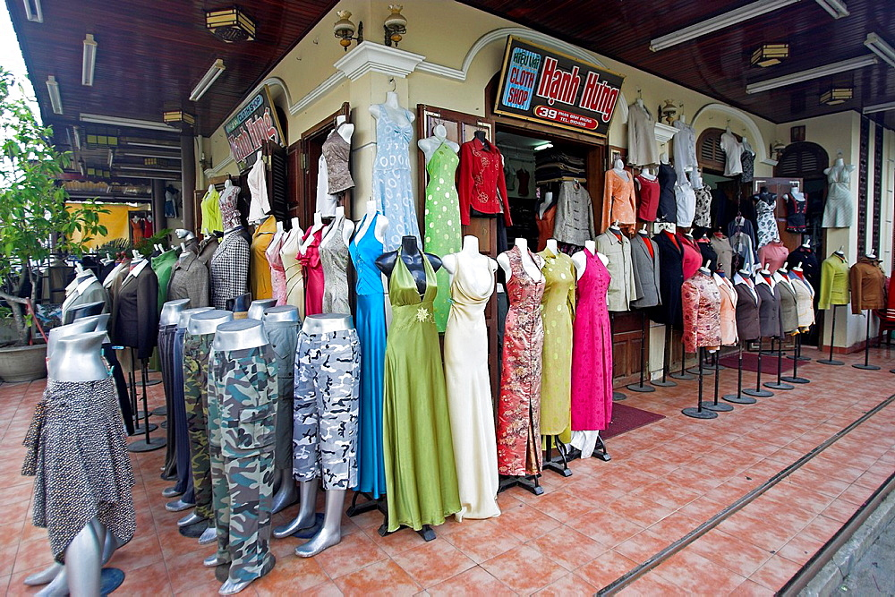 Cloth shop clothing styles display Hoi An historic town noted for tailoring and handicrafts mid Vietnam