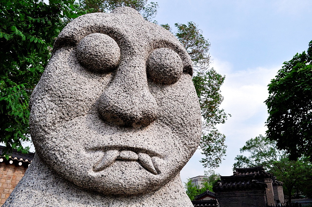 Seoul (South Korea): stone statues by the National Folk Museum; usually put at the entrance of a village or on the roadside, they were prayed for the abundance of crops and to protect the villagers against evil spirits, ghosts and diseases