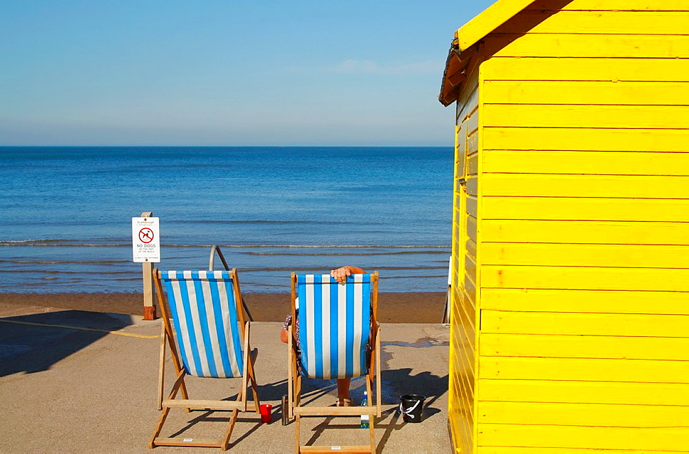 Deckchairs and beach hut at Whitby, North Yorkshire, England, UK