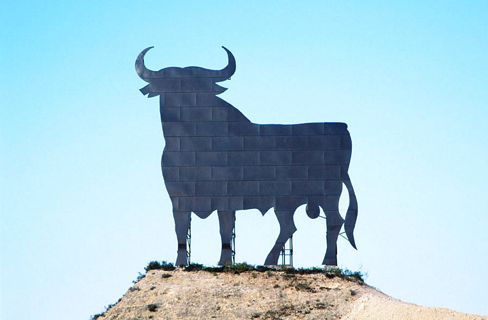 Bull silhouette, typical advertising of Spanish brandy Osborne, Andalusia, Spain
