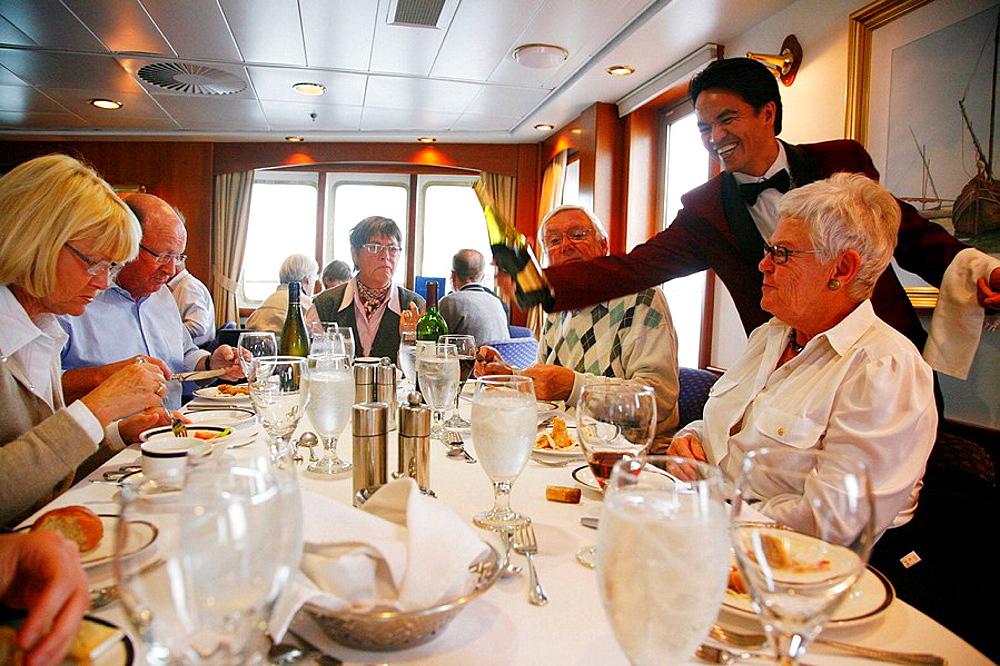 People eating on board the Clipper Adventurer cruise ship sailing in Greenland.