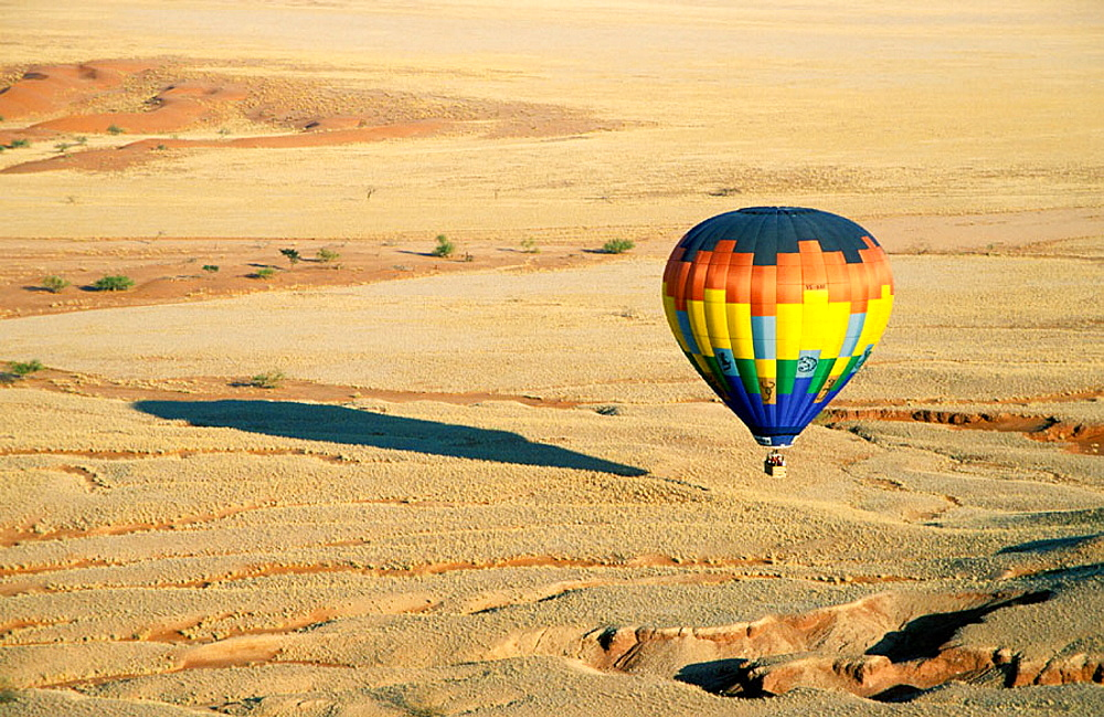 The hot-air balloon above eroded landscape at the edge of the Namib Desert, Namib-Naukluft Park, Namibia.