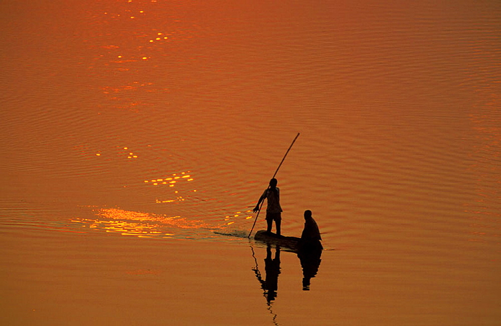 Fishermen at sunset on the Luangwa river, South Luangwa National Park, Zambia.