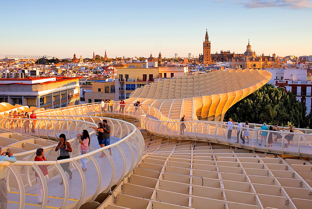 Top of Metropol Parasol, in Plaza de la Encarnacion, in background the cathedral, Sevilla, Andalucia, Spain