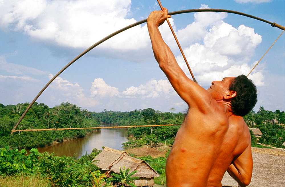 Mayoruna indian with his bow and arrows, San Jose de Anusi village, Galves River, tributary of the river Amazon, Peru
