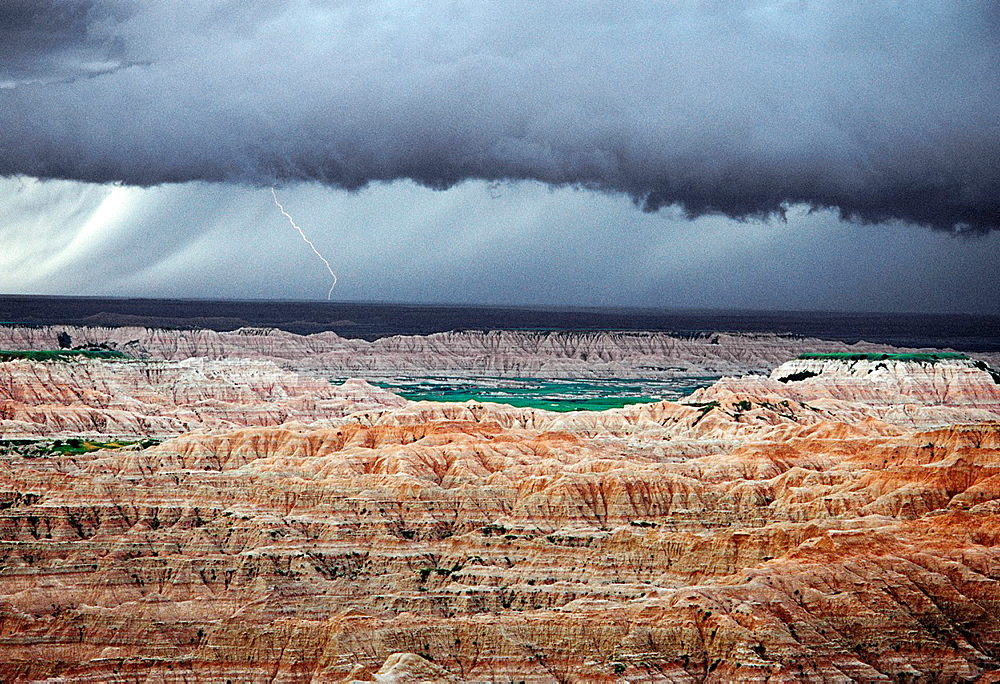 Lightning storm above sedimentary formations, North Unit, Badlands National Park, South Dakota, USA