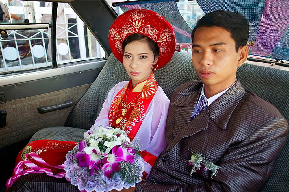 Couple going to their wedding, crossing a river by ferry, Vinh Long, Mekong Delta, Vietnam